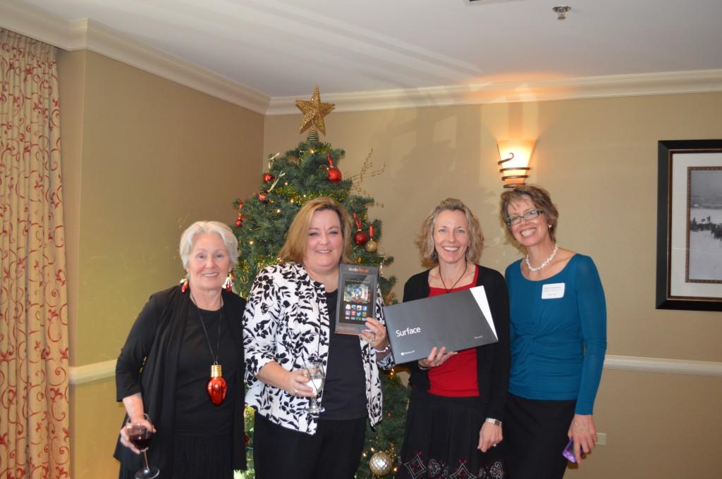 Reba Nance, Kim Utesch-winner of Kindle Fire HD, Kirstin Smith-winner of Microsoft RT, Barb Cashman-SSF Chair